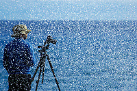 water from a large wave splashes between the camera and photographer Carsten Lehmann looking like heavy snow, Kapoho, The Big Island of Hawaii