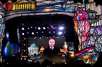01/01/2020, Moscow, Russia.<br /> President Vladimir Putin addresses crowds from an outdoor screen as revellers celebrate Russian New Year in central Moscow.