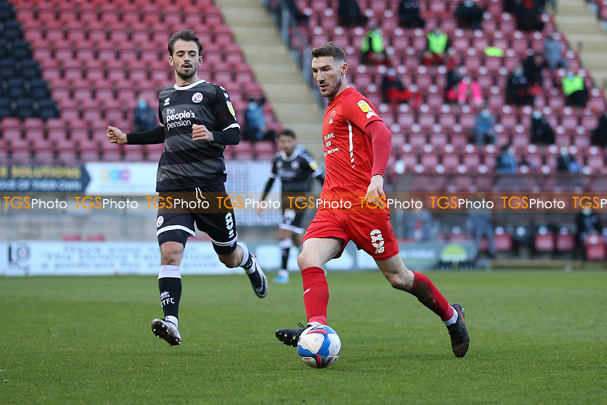 Craig Clay of Leyton Orient and Jack Powell of Crawley Town during Leyton Orient vs Crawley Town, Sky Bet EFL League 2 Football at The Breyer Group Stadium on 19th December 2020