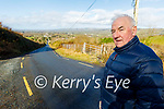 Charlie Farrelly standing on the road that needs gritting in Cordal