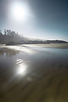 Pacific Rim National Park Reserve, Long Beach, surreal sunrise scenery of the sandy ocean shore during low tide in bright summer sunshine. Tofino, Vancouver Island, BC, Canada. Image © MaximImages, License at https://www.maximimages.com