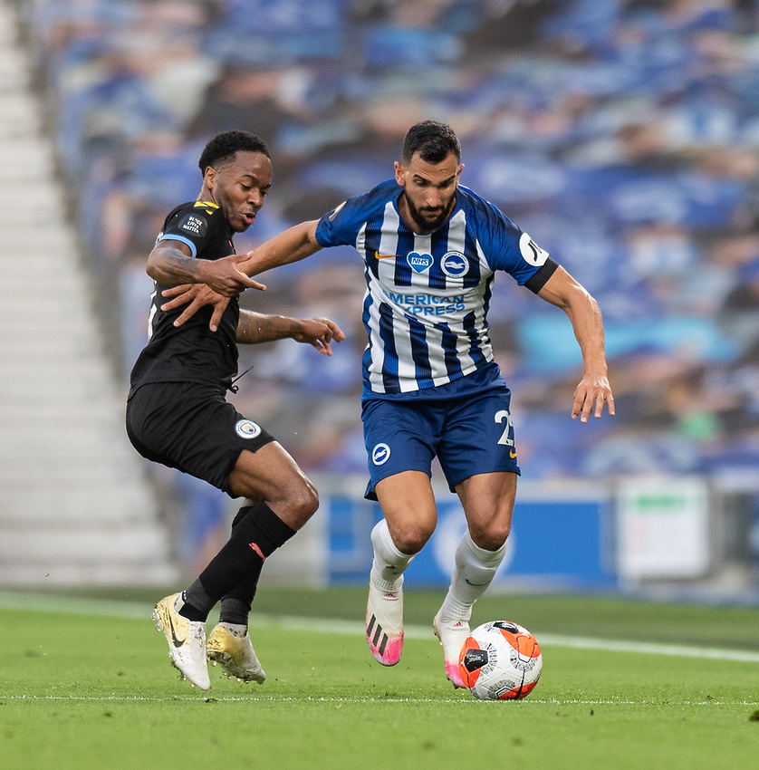 Manchester City's Raheem Sterling (left) battles with Brighton & Hove Albion's Martin Montoya (right) <br /> <br /> Photographer David Horton/CameraSport<br /> <br /> The Premier League - Brighton & Hove Albion v Manchester City - Saturday 11th July 2020 - The Amex Stadium - Brighton<br /> <br /> World Copyright © 2020 CameraSport. All rights reserved. 43 Linden Ave. Countesthorpe. Leicester. England. LE8 5PG - Tel: +44 (0) 116 277 4147 - admin@camerasport.com - www.camerasport.com