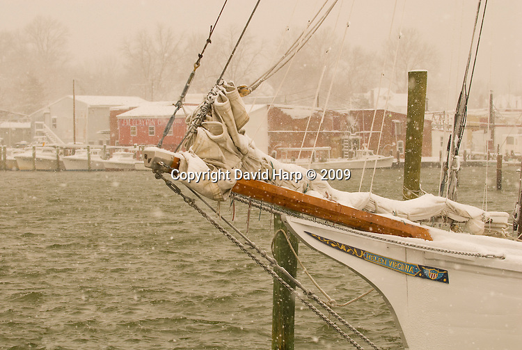 The skipjack Helen Virginia, its dredging days over, tied to the dock in Cambridge during oyster season.
