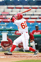 Outfielder Zhang Hongbo (60) of the China National Team hits a home run during a game vs. the Houston Astros Instructional League team at Holman Stadium in Vero Beach, Florida September 28, 2010.   China is in Florida training for the Asia games which will be played in Guangzhou, China in November.  Photo By Mike Janes/Four Seam Images