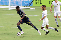 CARY, NC - AUGUST 01: Hadji Barry #92 is chased by Bruno Lapa #8 during a game between Birmingham Legion FC and North Carolina FC at Sahlen's Stadium at WakeMed Soccer Park on August 01, 2020 in Cary, North Carolina.