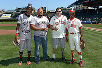 Jacob Gatewood (left) and Darius Day (right) pose with members of the Wounded Warrior Project after the ceremonial first pitch before the Under Armour All-American Game on August 24, 2013 at Wrigley Field in Chicago, Illinois.  (Mike Janes/Four Seam Images)