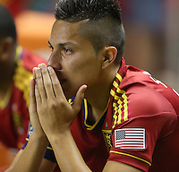 Carlos Salcedo #16 of Real Salt Lake wipes tears from his eyes after they lost to D.C. United at the U.S. Open Cup Final on October  1, 2013 at Rio Tinto Stadium in Sandy, Utah. DC United beat Real Salt Lake 1-0 to win the championship.