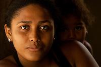 Elani Batista de Araújo, 18 anos, solteira, nasceu em Sao Domingos do Capim e mora com os pais que trabalham na lavoura sustentando mais sete irmãos. Para Elani a o surf na pororoca tra's a cidade possibilidade de conhecer novas pessoas e muitas festas.<br /> São Domingos do Capim, Pará, Brasil.<br /> Foto Paulo Santos<br /> 10/03/2012