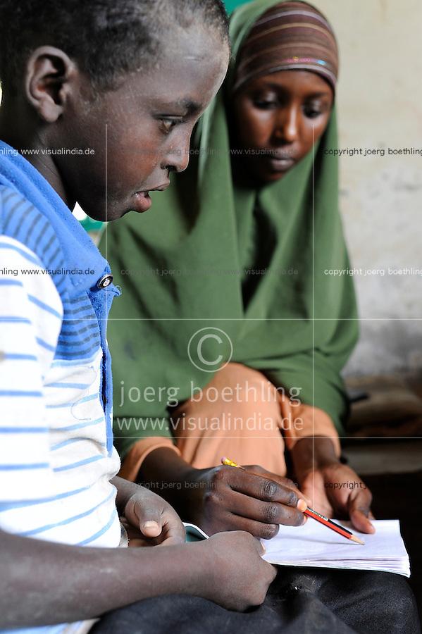 KENIA Fluechtlingslager Kakuma in der Turkana Region , hier leben ca. 80.000 Fluechtlinge ,  JRS JESUIT REFUGEE SERVICE Schule und trauma counselling / KENYA Turkana Region, refugee camp Kakuma, where 80.000 refugees live,  JESUIT REFUGEE SERVICE school and trauma counselling, Somali boy and woman