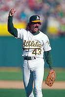 OAKLAND, CA - Dennis Eckersley of the Oakland Athletics celebrates during Game 4 of the American League Championship Series against the Toronto Blue Jays at the Oakland Coliseum in Oakland, California in 1992. Photo by Brad Mangin