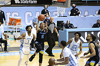 CHAPEL HILL, NC - FEBRUARY 24: Greg Elliott #5 of Marquette shoots a layup during a game between Marquette and North Carolina at Dean E. Smith Center on February 24, 2021 in Chapel Hill, North Carolina.