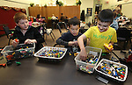 From left, Trenton Thompson, 9, Trevor Palmer and Lance Hornemann, both 6, play at the Lego Club event at the Carson City Library, in Carson City, Nev., on Saturday, Dec. 17, 2011. .Photo by Cathleen Allison
