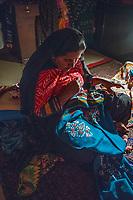 India, Gujarat, Bhadroi, Kutch Desert. Pabiben working at night.