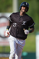 Micker Adolfo (27) of the Kannapolis Intimidators rounds the bases after hitting a home run against the hs\ at Kannapolis Intimidators Stadium on June 15, 2017 in Kannapolis, North Carolina.  The Intimidators walked-off the Suns 5-4 in game one of a double-header.  (Brian Westerholt/Four Seam Images)