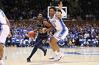 DUKE, NC - FEBRUARY 15: T.J. Gibbs #10 of the University of Notre Dame is fouled by Wendell Moore Jr. #0 of Duke University during a game between Notre Dame and Duke at Cameron Indoor Stadium on February 15, 2020 in Duke, North Carolina.