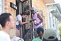 Freshman Rebekah Oviatt helps homeowner Doris Early remove a screen as Tulane freshmen voluntees with South Seventh Ward Neighbors, 2016.