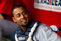 Alberto Rosario (24) of the Arkansas Travelers smiles in the dugout during a game against the Springfield Cardinals on May 10, 2011 at Hammons Field in Springfield, Missouri.  Photo By David Welker/Four Seam Images.