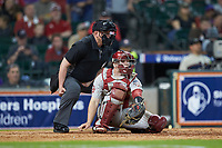 Oklahoma Sooners catcher Justin Mitchell (14) reaches for a pitch as home plate umpire Ken Langford looks on during the game against the LSU Tigers in game seven of the 2020 Shriners Hospitals for Children College Classic at Minute Maid Park on March 1, 2020 in Houston, Texas. The Sooners defeated the Tigers 1-0. (Brian Westerholt/Four Seam Images)
