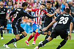 Yannick Ferreira Carrasco (r) of Atletico de Madrid competes for the ball with Raphael Varane (l) of Real Madrid during their 2016-17 UEFA Champions League Semifinals 2nd leg match between Atletico de Madrid and Real Madrid at the Estadio Vicente Calderon on 10 May 2017 in Madrid, Spain. Photo by Diego Gonzalez Souto / Power Sport Images