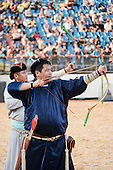 A Mongol indigenous archer demonstrates his archery technique at the International Indigenous Games, in the city of Palmas, Tocantins State, Brazil. Photo © Sue Cunningham, pictures@scphotographic.com 24th October 2015