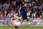 Nagatomo Yuto of Japan (R) fights for the ball with Alireza Jahan Bakhsh Jirandeh of Iran (L) during the AFC Asian Cup UAE 2019 Semi Finals match between I.R. Iran (IRN) and Japan (JPN) at Hazza Bin Zayed Stadium  on 28 January 2019 in Al Alin, United Arab Emirates. Photo by Marcio Rodrigo Machado / Power Sport Images