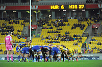 TJ Perenara watches Aaron Smith feed a scrum during the Super Rugby match between the Hurricanes and Highlanders at Westpac Stadium, Wellington, New Zealand on Saturday, 6 July 2013. Photo: Dave Lintott / lintottphoto.co.nz