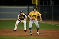 Siena Saints Pat O'Hare (17) leads off in front of first baseman Connor Allen (39) during a game against the UCF Knights on February 14, 2020 at John Euliano Park in Orlando, Florida.  UCF defeated Siena 2-1.  (Mike Janes/Four Seam Images)