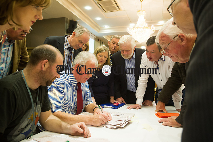 The doubtful ballots are examined by candidates and their reps. during the election count at The West county Hotel, Ennis. Photograph by John Kelly.