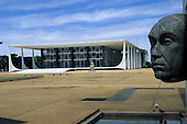 Brasilia, Brazil. Head of Juscelino Kubitschek with the Palace of Justice; Praca dos Tres Poderes.
