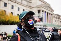 NEW YORK, NY - OCTOBER 24: A woman sticks her voting sticker on her face mask next to the Brooklyn Museum during early voting for the United States presidential election on October 24, 2020 in New York City. Due to concerns about the coronavirus and social distancing, New York State is allowing early voting for the first time to protect voters from new infections in the city (Photo by Pablo Monsalve / VIEWpress via Getty Images)