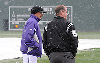 Furman Paladins head coach Ron Smith checks field conditions with an umpire after a game against the Northwestern Wildcats was stopped after five innings due to heavy snow on Saturday, February 16, 2013, in Greenville, South Carolina. After a 90-minute delay the game was cancelled. (Tom Priddy/Four Seam Images)