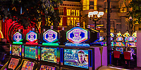 Typical casino slot machines with the beautiful interior facades of the Paris Hotel in the background, on Las Vegas Strip in Nevada