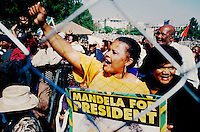 People gather outside Pretoria's Union Buildings for the inauguration of Nelson Mandela as President.
