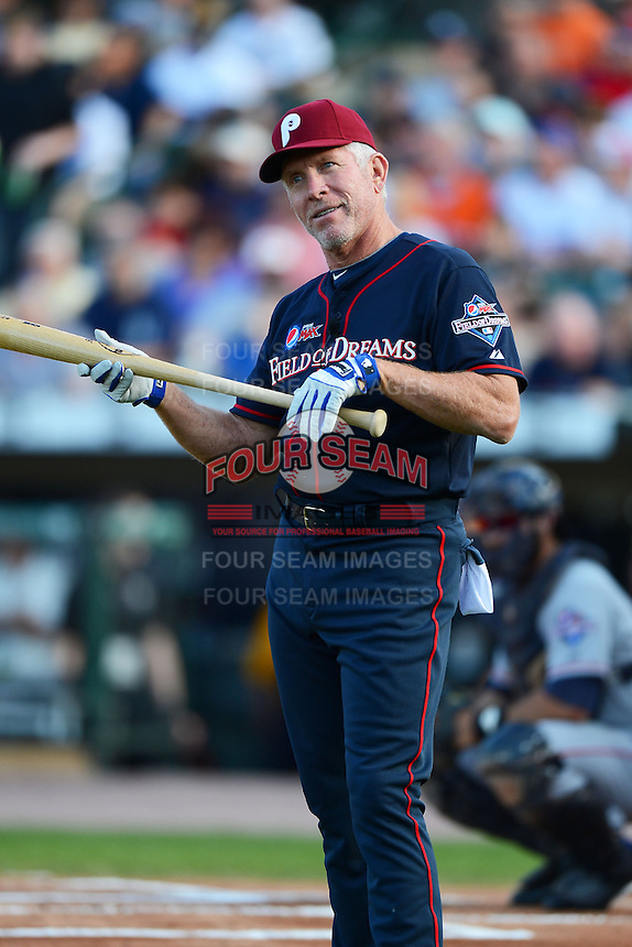 Hall of Fame third baseman Mike Schmidt #20 gestures to Joe Altobelli (not pictured) asking if he should bunt during the MLB Pepsi Max Field of Dreams game on May 18, 2013 at Frontier Field in Rochester, New York.  (Mike Janes/Four Seam Images)