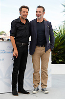 """CANNES, FRANCE - JULY 17: French director Nicolas Bedos (L) and French actor Jean Dujardin at photocall for the film """"OSS 117 : Alerte Rouge en Afrique Noire"""" (OSS 117 : From Africa With Love) at the 74th annual Cannes Film Festival in Cannes, France on July 17, 2021 <br /> CAP/GOL<br /> ©GOL/Capital Pictures"""