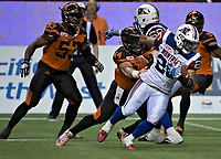 Vancouver, September, 09, 2016 - Alouette Tyrell Sutton[R] tries to avoid Lions Adam Bighill. The Montreal Alouettes lost to the BC Lions 27-38. (Andrew Soong)
