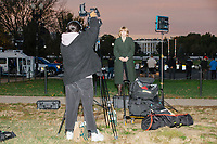 A television reporter waits for broadcast on the National Mall near the White House on the night of Election Day in Washington, D.C., on Tue., Nov. 3, 2020. Election results remained uncertain late into the night and demonstrators were peaceful.