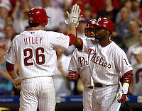 Philadelphia Phillies Chase Utley (L) celebrates with his teammte Jimmy Rollins (R) at home plate after Utley hit a two run home run scoring Rollins during fourth inning MLB action against the San Francisco Giants in Philadelphia, Pennsylvania, May 7, 2006. REUTERS/Bradley C Bower
