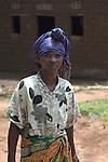 Community Health Worker Marie Chantal walking into her village,  Batamuliza Hururiro near Rukumo Health Center, Rwanda....