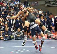 Servite's Anthony Licata is lifted in the air by his opponent, Trabuco Hills' Matt Roxas during their match.