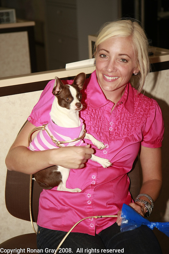 """Friday, June 20, 2008 was take your dog to work day at Caldwell Banker in Mission Beach, California USA.  Nicole Simpson and """"Bella""""."""