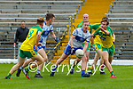 Patrick Hickey Desmonds looks to offload to Dominic Finnegan as Gneeveguilla Paul O'Leary and Damien Cronin try to block them during their SFL Div 2 promotion playoff in Fitzgerald Stadium on Sunday