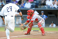 Hagerstown Suns catcher Pedro Severino #4 prepares to field the ball for a play at the plate during a game against the Asheville Tourists at McCormick Field on May 28, 2013 in Asheville, North Carolina. The Tourists won the game 9-4. (Tony Farlow/Four Seam Images)
