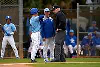 Indiana State Sycamores Dominic Cusumano shows the umpire where he was hit by a pitch as head coach Mitch Hannahs looks on during a game against the Dartmouth Big Green on February 21, 2020 at North Charlotte Regional Park in Port Charlotte, Florida.  Indiana State defeated Dartmouth 1-0.  (Mike Janes/Four Seam Images)