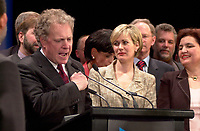 April 14, 2003, Montreal, Quebec, Canada<br /> <br /> Jean Charest, Leader of  Quebec Liberal Party <br /> and Quebec new Premier and his wife (R) adresses the Liberal  troops in Montreal on the  provincial election night,<br /> <br /> the election results are<br />  45,4 % of the vote for his Jean Charest's Liberal party,<br /> 33,4 % of the vote for Bernard Landry's Parti Quebecois and<br /> 18,6 % of the votes for Mario Dumont's Action Democratique du Quebec<br /> <br /> <br /> Mandatory Credit: Photo by Pierre Roussel- Images Distribution. (©) Copyright 2003 by Pierre Roussel