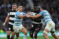 Siya Kolisi of Barbarians (Stormers & South Africa)  is tackled by Pablo Matera (c)of Argentina during the Killik Cup match between the Barbarians and Argentina at Twickenham Stadium on Saturday 1st December 2018 (Photo by Rob Munro/Stewart Communications)