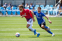 SAN JOSE, CA - APRIL 24: Tanner Tessmann #15 of FC Dallas outpaces Eric Remedi #5 of the San Jose Earthquakes during a game between FC Dallas and San Jose Earthquakes at PayPal Park on April 24, 2021 in San Jose, California.
