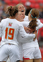 COLLEGE PARK, MD - OCTOBER 28, 2012:  Players of the University of Maryland congratulate Alex Reed (7)  after she scored the first goal against Miami during an ACC  women's tournament 1st. round match at Ludwig Field in College Park, MD. on October 28. Maryland won 2-1 on a golden goal in extra time.