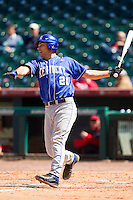 Luke Maile #21 of the Kentucky Wildcats follows through on his swing against the Utah Utes at Minute Maid Park on March 6, 2011 in Houston, Texas.  Photo by Brian Westerholt / Four Seam Images