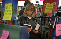 A customer makes her selections at the  Westerville, Ohio, B. Dalton bookstore on the final day of sales at the suburban store. The store, one of the smallest in the chain, was closing after nearly two decades tucked in the corner of a building housing an insurance company and a balloon store.(Gary Gardiner/EyePush Newsphotos)<br />